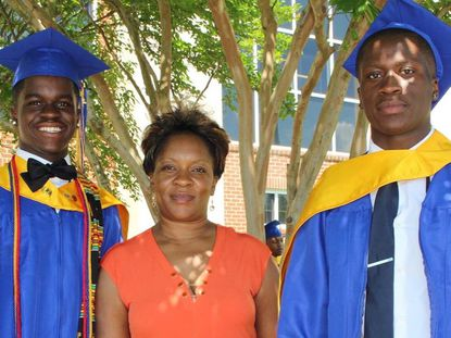 John Daka, right, with his twin brother, Golden, and mother, Vizzie Wayuma-Okpalobi, at their high school graduation in 2016.