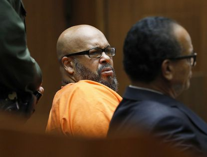"""Former rap mogul Marion """"Suge"""" Knight, left, with his defense attorney Albert DeBlanc Jr., listens to the terms of his plea of no contest to voluntary manslaughter Thursday, Sept. 20, 2018, after he ran over two men, killing one, nearly four years ago."""