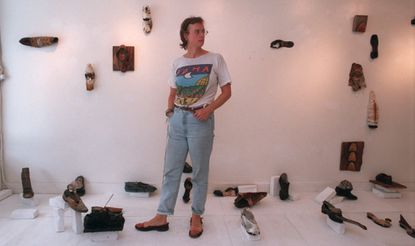Baltimore artist Ruth E. Pettus in her exhibit on display at the Resurgam Gallery featuring a collection of transformed old shoes.
