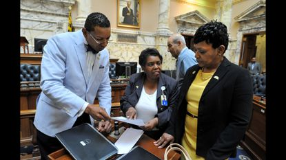 Democratic Del. Tawanna Gaines, center, is shown during the 2015 Maryland General Assembly session with Del. Keith Haynes and Del. Adrienne A. Jones, who is now speaker of the House of Delegates. Gaines has resigned from the House of Delegates.