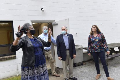 Carroll County Veterans Independence Project board members, from left, Anna-Maria Halstead, Frank Valenti, Ed Cramer and Ann Gilbert try to envision uses of the space outside the new veterans services center location at 95 Carroll Street in Westminster Friday, October 16, 2020.
