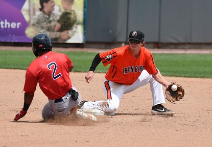 Aberdeen infielder Clay Fisher makes the catch and sets up to make the tag on Lowell baserunner Kervin Suarez during Tuesday afternoon's game at Leidos Field at Ripken Stadium.