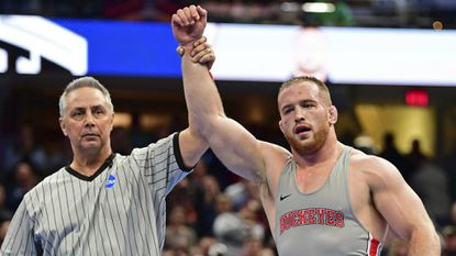 Ohio State's Kyle Snyder, right, has his arm raised after defeating Michigan's Adam Coon during the 285-pound championship match of the NCAA Division I wrestling championships last month.