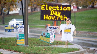 Signs line the sidewalk outside of Robert J. DiPietro Community Center on Election Day in Laurel on Nov. 7.