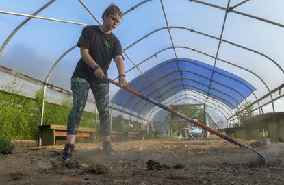 Ashlynn Kidwell , a 16-year-old junior from Century High School works on, what will be, a new butterfly tent at the Carroll County Ag Center. A $1000 grant for her and the 4H is helping pay for materials as she and other volunteers provide the labor in preparation for the upcoming fair in August.