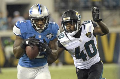 Detroit Lions wide receiver Jeremy Ross, left, catches a pass in front of Jacksonville Jaguars cornerback Rashaad Reynolds (40) during the second half of a preseason game in Jacksonville, Fla., Friday, Aug. 28, 2015.