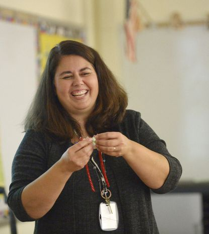 North Carroll Middle School teacher Denise Kresslein demonstrates to students how to build a model of the DNA molecule using licorice and marshmallows in class Thursday, October 31, 2019.