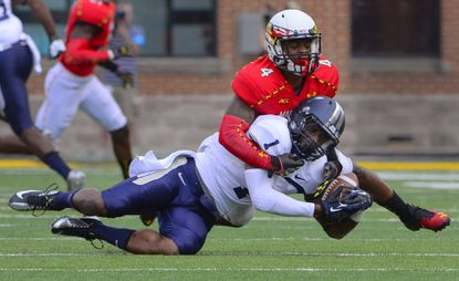 Maryland cornerback Will Likely covers Old Dominion wide receiver Jakwail Bailey during a 2013 game.