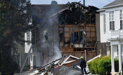 Everton Garfield Brown, 56, killed three of his neighbors Saturday and was fatally shot by police after an explosion collapsed and burned his Parkview Crossing town house and an attached house in the 7500 block of Maury Road, officials said.