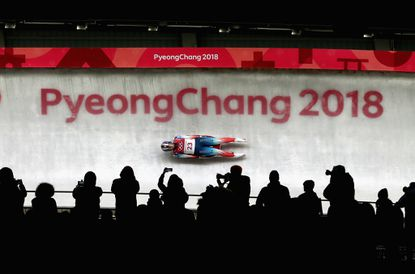 Emily Sweeney slides during the women's luge event at the Pyeongchang Olympics on Feb. 13, 2018.