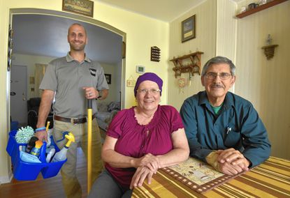 """Eric Landers, left, owner of Landers Cleaning Co., and Mark and Linda Persiani. Linda Persiani is a cancer patient. Landers Cleaning Co. is partnered with the non-profit organization, """"Cleaning for a Reason."""""""
