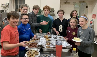 Youth Group members gather to work in the kitchen at Trinity Church in Towson on Shrove Tuesday.