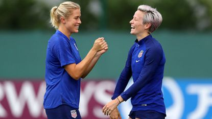Abby Dahlkemper of the USA (L) shares a joke with Megan Rapinoe of the USA (R) during a training session at Lyon Training Center. (Photo by Elsa, Getty Images)