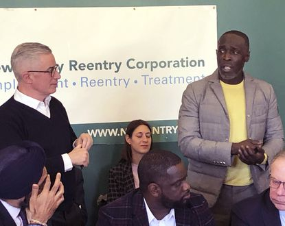 Actor Michael K. Williams, right, speaks at news conference on prisoner reentry sponsored by New Jersey Reentry Corporation in Newark, N.J., on Feb. 14, 2020. At left is NJRC chairman and former New Jersey Gov. Jim McGreevey. At lower left is New Jersey Attorney General Gurbir Grewal. (AP Photo/David Porter)