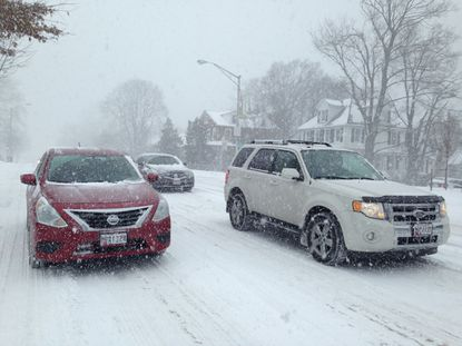Cars on York Road near the Baltimore-Towson line move slowly.