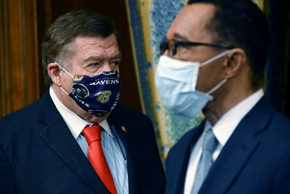 Congressman C.A. Dutch Ruppersberger, wearing a Ravens-themed face mask, and Congressman Kweisi Mfume in the Rayburn Room of the U.S. Capitol following the ceremonial swearing-in for Mfume.