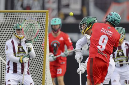 Redwoods goalie Tim Troutner Jr., facing a shot from Whipsnakes attackman Matt Rambo during a 2019 game in Hamilton, Ontario, is one of the starting goalies for the Premier Lacrosse League All-Star game.