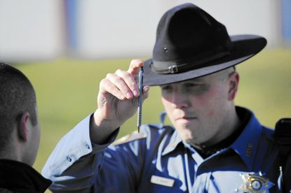 Carroll County Sheriff's Office Master Deputy Tom Vanik demonstrates the horizontal gaze nystagmus test, part of the field sobriety test used by officers to evaluate drivers suspected of driving under the influence.