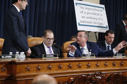 House Judiciary Committee ranking member Rep. Doug Collins, a Georgia Republican right, speaks to Chairman Rep. Jerrold Nadler, a New York Democrat, center, and Democratic counsel Norm Eisen during a hearing before the House Judiciary Committee on the constitutional grounds for the impeachment of President Donald Trump, on Capitol Hill in Washington last week.