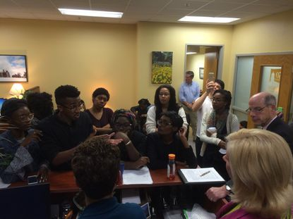A group of about two dozen black Towson University students brought a list of 13 demands to the school's interim President Timothy Chandler's office Wednesday and reviewed them with him until after midnight, when he pledged to address them.