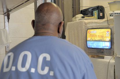 An inmate watches his clear-case television at JCI (Jessup Correctional Institution).