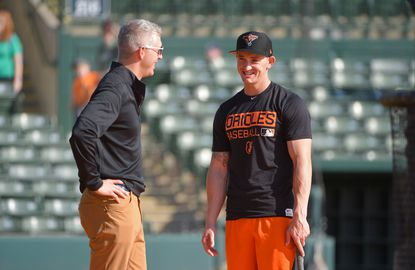 Orioles' general manager Mike Elias talks with Austin Hays during spring training. Hays was called up over the weekend.