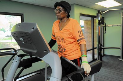 """Dianne Harrod, 65, walks on a treadmill in her building's gym. She is living with metastatic breast cance and credits her positive attitude and her diet for her survival. """"It's what you eat and what you do and don't feel sorry for yourself."""""""