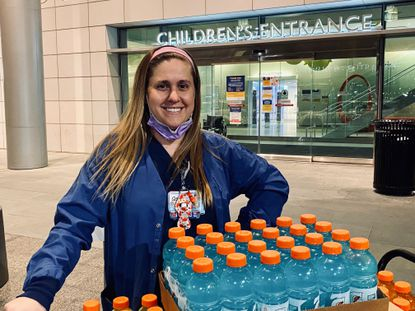 Sarah Rutter poses with bottles of Gatorade, which were donated by members of Manchester Valley High School's girls lacrosse team.
