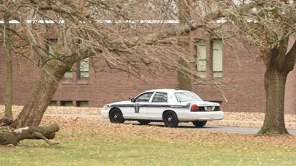 An Aberdeen Police car drive into the parking lot at Aberdeen Middle School on Wednesday, Dec. 20. City police say they have charged an eighth-grade student in connection with a threat of violence at the school posted Tuesday on social media.