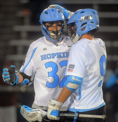 Johns Hopkins junior Shack Stanwick (32) reacts to his goal while being congratulated by Wilkins Dismuke during the second period against Rutgers at Homewood Field on March 31, 2017.