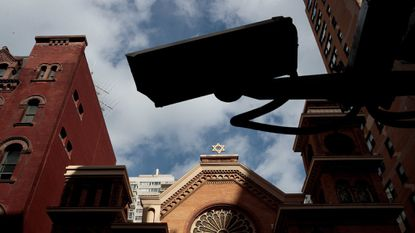 A security camera hangs across the street from the Park East Synagogue on March 3, 2017, in New York City.