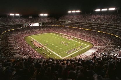 The first game is played at the Ravens' new downtown stadium. It would later be named PSINet Stadium and renamed M&T Bank Stadium in 2003.