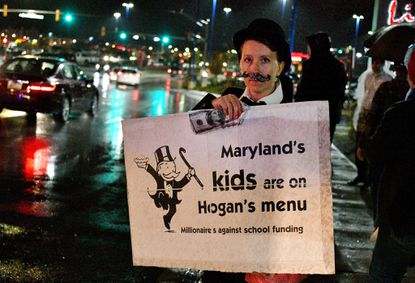 "Amalie Ward, parent of Baltimore school students, was one of the protesters who dressed satirically as ""millionaires"" to protest the ""dark money"" fundraiser held by Gov. Larry Hogan at Live! Casino and Hotel. The education advocates were supporting full funding of public education and social services recommended by the Kirwan Commission."
