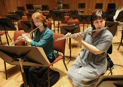 Emily Skala, principal flute for the Baltimore Symphony Orchestra, right, takes a portion of her lunch break to work with amateur flutist, Carolyn Williams from Towson in 2010. (Algerina Perna/Baltimore Sun).
