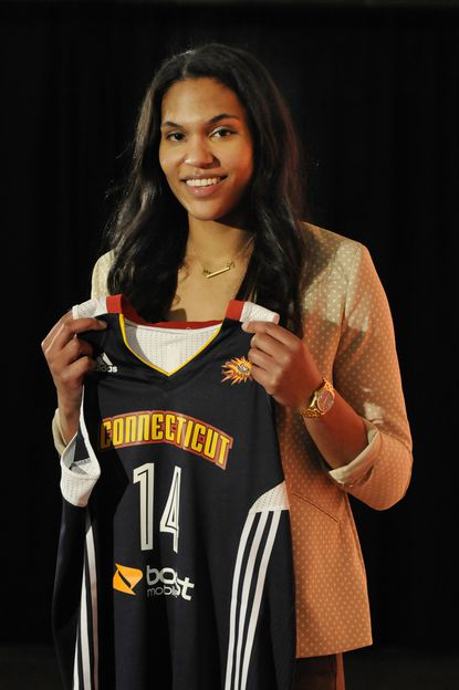 Alyssa Thomas poses with a Connecticut Sun jersey after the WNBA draft. The former Maryland standout was selected by the New York Liberty fourth overall but then was traded to the Sun.