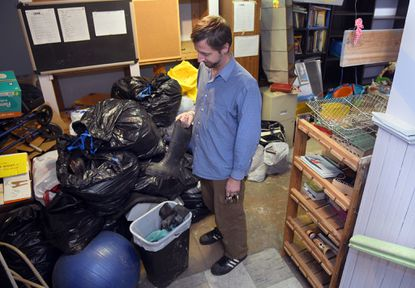 Craig Bettenhausen in 2019 at the Church of the Guardian Angel in Remington looking at items that might be salvageable in the church basement after its third sewage backup in a few months.