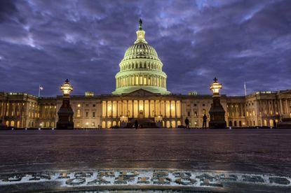 Lights shine inside the Capitol BuildingonJan. 21, 2018.