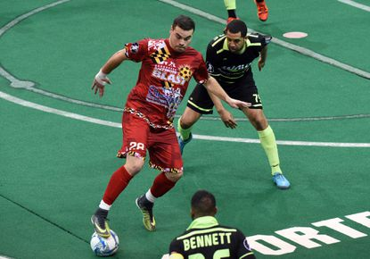 Towson, MD--March 16, 2018--Baltimore Blast vs Milwaukee Wave mens' soccer eastern conference final. Blast forward Vini Dantas, left, has control of the ball as Wave defender Jonatan Santos, right, is in pursut in the second period. Barbara Haddock Taylor
