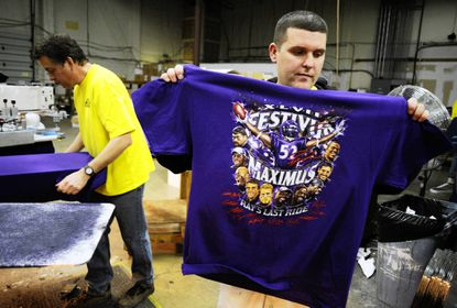 Stephen Tant, front, and Craig Dunklee, screenprinters at Nightmare Graphics, in Columbia, were busy Monday, Jan. 21 working on Baltimore Ravens Super Bowl T-shirts.