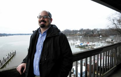 nne Arundel County government has hired environmentalist Erik Michelsen to run the county's storm water pollution program. Michelsen will oversee how the county spends the new storm water fees on projects to reduce pollution that harms rivers and the Chesapeake Bay. He's pictured on the deck outside the South River Federation.