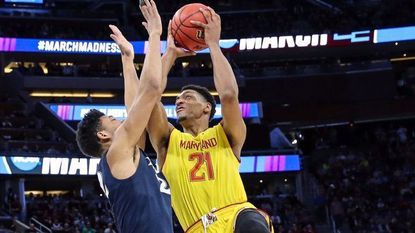 Maryland forward Justin Jackson shoots while being defended by Xavier forward Kaiser Gates during the first round of the NCAA tournament March 16, 2017 in Orlando, Fla.