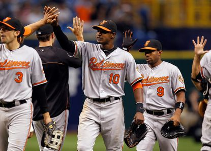 The Orioles celebrate their victory over Tampe Bay on Saturday, which snapped a six-game skid and allowed them to pull back into a first-place tie in the American League East.