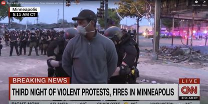 CNN reporter Omar Jimenez is arrested while covering the Minneapolis protests, May 29. The coronavirus pandemic and the new urban crisis have made it impossible to look away, and journalists have at times become targets for the police.