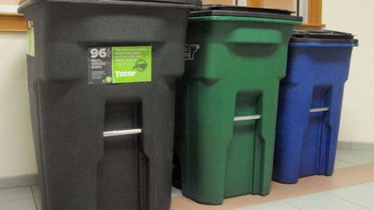 "Toter-brand containers, one for recycling and one for trash, will be distributed to city residents to be used as part of the city of Aberdeen's new flat fee trash collection program that will replace the ""pay-as-you-throw"" sticker program."