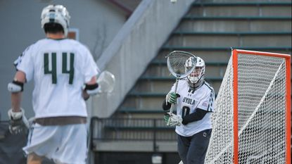 Junior goalkeeper Jacob Stover (0), pictured earlier this season, overcame a poor first half to help lift the top-seeded Loyola Maryland men's lacrosse team to a 13-8 victory over No. 6 seed Boston University in a Patriot League tournament semifinal Friday.