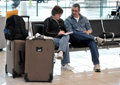 Arlene and David McLean, of Winslow, Maine, were able to fly to Baltimore- Washington International Thurgood Marshall Airport from Manchester, N.H., but have not been able to complete the second leg to Miami.