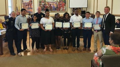 The Annapolis Police Department awarded nine scholarships to students, five of which were in honor of the Capital Gazette shooting victims.