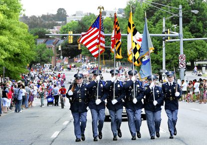 The Baltimore County Police Honor Guard marches in last year's Towson Fourth of July Parade.