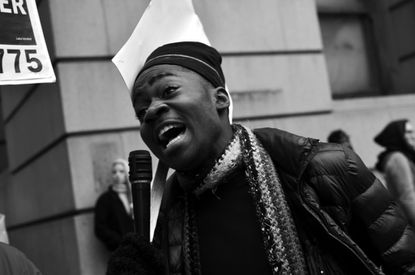 A protester outside the Clarence Mitchell Courthouse addresses a small crowd as the trial for Officer William Porter gets underway. Porter and five other Baltimore City Police officers are indicted in the death of Freddie Gray who died in police custody in April.