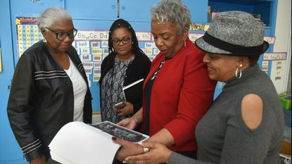 """From left, Sidney Ellis, Tracey Garrett, Linda Morris, Myra Owens Queen up in Cherry Hill and wrote, """"Cherry Hill: Raising Successful Black Children in Jim Crow Baltimore."""" They are photographed at Cherry Hill Elementary Middle School, where Ms. Garrett is principal."""
